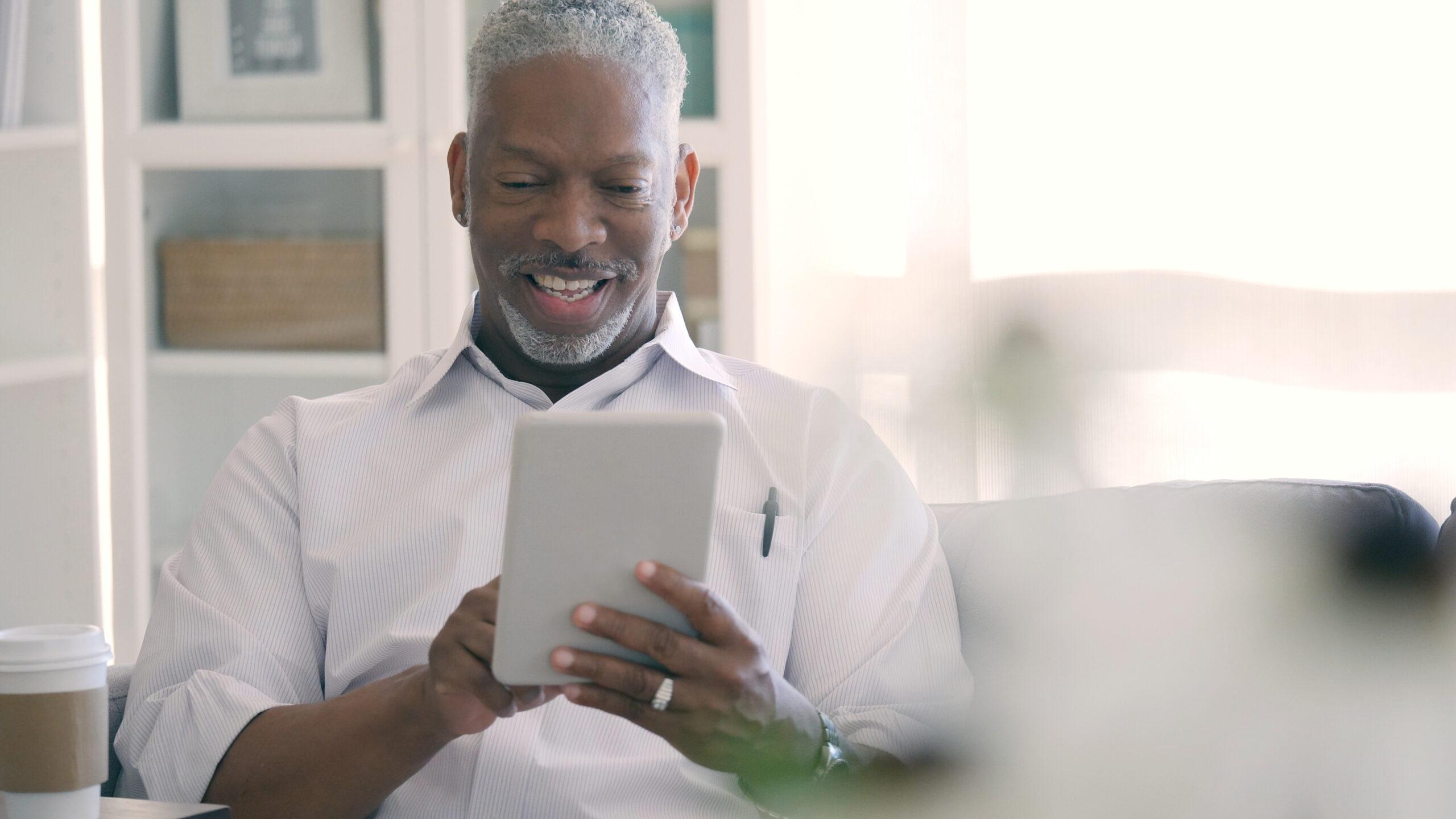 Male using digital tablet