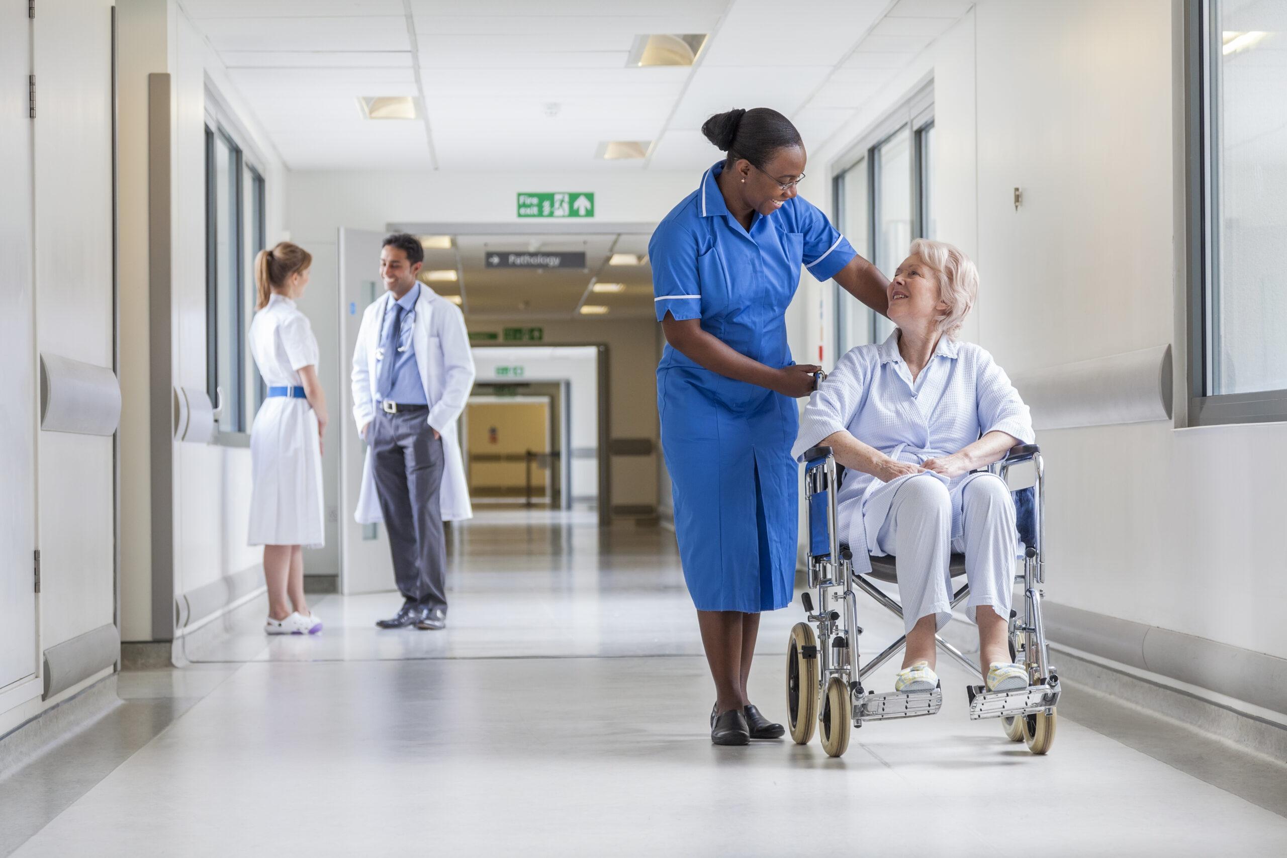 Female patient in wheelchair with nurse