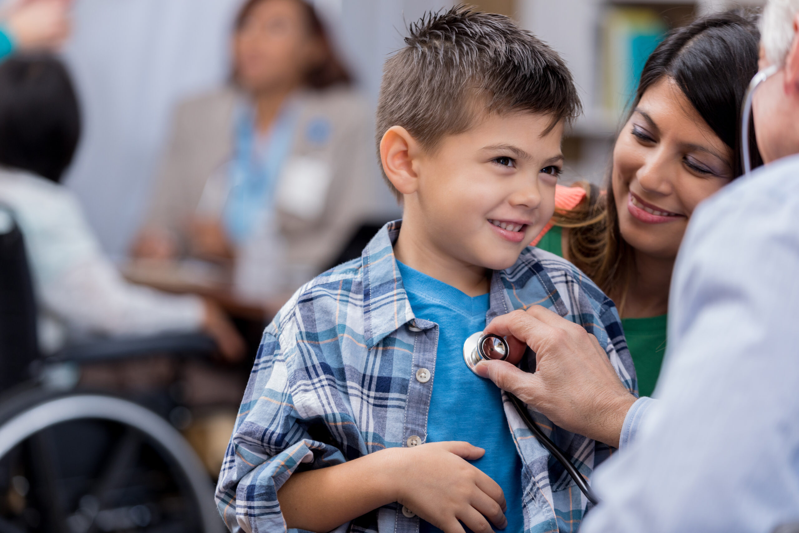Pediatrician examines young male patient
