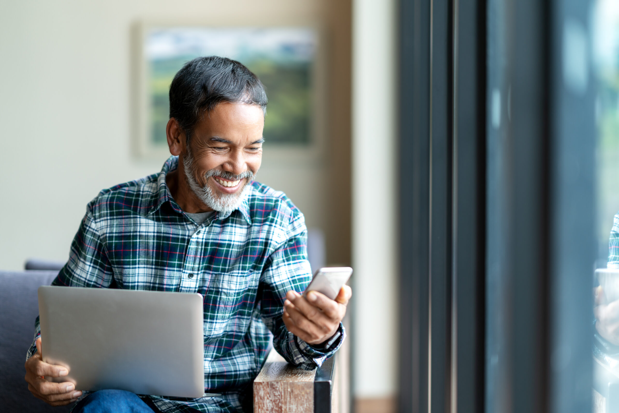 Man using mobile phone and smiling